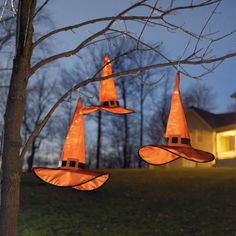 A twist on hanging lanterns or string lights, this set is oh-so-charming and surely will dazzle the neighborhood. Hang them anywhere, indoors or out.            Each bright-orange all-weather nylon hat is finished with a layer of black mesh and an orange buckle                Strung point to point, each is lit from within by 50 bright mini lights                Hang them from integrated hooks                Plug into a standard outlet    Length of cord between each hat is 36; cord from la...