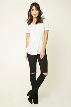 A heathered knit cotton-blend tee featuring a side-split hem, a round neckline, and short sleeves.