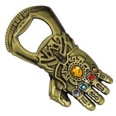 Marvel Avengers Infinity Gauntlet bottle opener. This cool design has five cz gems to replicate the Infinity Stones.  The Infinity Gauntlet is one of the most powerful objects in the Universe. It was designed to hold the Infinity Gems. When used in combination their already impressive powers make the wearer able to do anything they want.   #infinitygauntlet #marvel #avengers #thanos #giftideas #giftsforhim #giftsforher #vintagejewelryonline Marvel Dc Comics, Marvel Avengers, Infinity Gems, The Infinity Gauntlet, Gifts For Him, Bottle Opener, Cool Designs, Vintage Jewelry, Objects