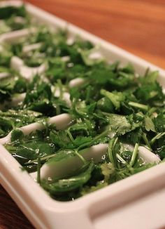A quick and easy way to freeze fresh herbs. Never let that half bunch of cilantro go to waste again!
