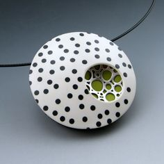 Retro black and white polkadot pendant necklace with silver accent and a pop of color. $65.00, via Etsy.
