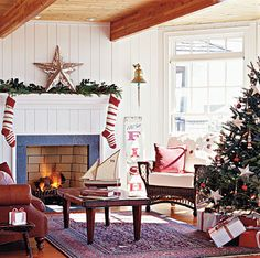 Use coordinating wrapping paper to match gifts to your holiday decorating scheme. Boats and ship's bells ring in the season, and primitive accents lend folk-art flair to this living room. Nautical Christmas, Beach Christmas, Christmas Love, All Things Christmas, Christmas Holidays, Merry Christmas, Christmas Ideas, Happy Holidays, England Christmas