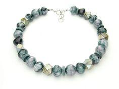 Halskette in anthrazit/ grau/blau  Schillernde Natürlichkeit. Faszinierende Schlangenlederperlen kombininert mit Papermaché-Perlen, Acrylatrobolen, Minkscheiben und Ringen aus facettierten Glasperlen gefasst an Ziegenlederschnüren. Länge: 46 cm   http://www.langani.de/de/kollektion-de/2015herbst-winter/category/174-winterblau.html #langani #schmuck #jewelry #necklace #pearls