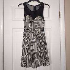 HP🎉 Black & White Asymetrical Pattern Party Dress This super cute dress is in EXCELLENT used condition! Worn only ONCE to a party a couple years ago. Colors are black & white. Top chest and back area are paneled in black sheer mesh material and the sides also have the same material as well. Zipper is in back. Brand is Material Girl and the size is M. Such a fun, cute dress to wear for different occasions! 🎉 Material Girl Dresses