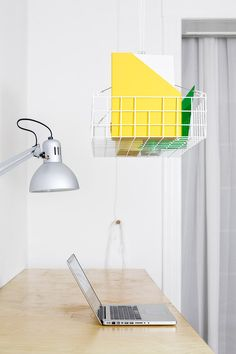 Dalt storage system hangs from the ceiling to save space in small apartments.