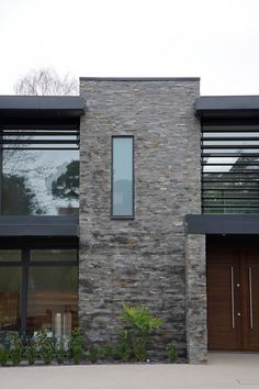 Designed by David James Architects in Dorset, England, Nairn Road Residence displays a sober modern exterior appearance. Facade Design, House Design, Timber Staircase, Building Stone, Stone Cladding, Stone Facade, House Entrance, Modern Exterior, Stone Exterior