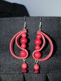 Red leather earrings.