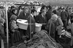 The little white coffin of Eileen Kelly, 6 years, arrives at the graveside in Milltown Cemetery. Her father is side on to the camera and wearing a pin-striped suit. Eileen died, 30th October 1975, in a Provisional IRA gun atttack targeting her father who was described as a Republican Clubs sympathiser. The Republican Clubs organization is the political wing of the Official IRA. The funeral was on 3rd November 1975. 197511030711b..Copyright Image from Victor Patterson, 54 Dorchester Park…