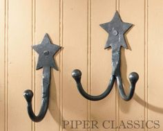 """The hand forged design of the Double Star Hook was inspired by authentic pieces of the 18th & 19th centuries.  Made from natural iron with an antiqued natural iron finish. Add an appealing vintage look to a practicle item when used in the bath or kitchen for hanging pot holders, towels, caps, jacket or keys.  4.5"""" high.  4 1/2"""" H Antiqued natural iron finish"""