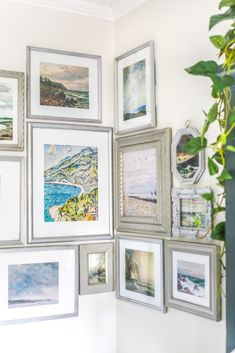 A free printable set of a coastal gallery wall featuring antique ocean paintings and how to frame them inexpensively with thrifted finds.