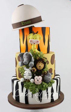 Safari Cake Take your celebration on a journey of discovery. Diy 1st Birthday Party, Safari Birthday Cakes, Jungle Theme Cakes, Animal Themed Birthday Party, Jungle Theme Birthday, Safari Cakes, Safari Birthday Party, Baby Boy 1st Birthday, Cool Birthday Cakes