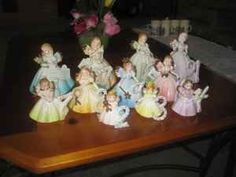 Porcelain Birthday Angels... Mine were forever getting the wings broken off (or in one traumatic incident, beheaded). My grandmother gave me one every year on my birthday.
