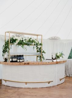 All white and greenery bar decor: http://www.stylemepretty.com/2017/03/02/10-trends-every-2017-brides-need-to-know-easton-events/ Photography: Jose Villa - http://josevilla.com/