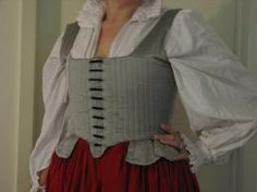 "Bodies:  Today called a bodice or a corset, the ""pair of bodyes"" was stiffened with whalebone (baleen), reeds, or buckram linen.  The fastenings in 1580 seem to be either lacings or hooks and eye in the front and lacing only in the back, and extensive research seems to suggest that front lacing was more common. READ more at Extreme Costuming"