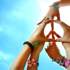 This would be cool if we made a cross in the middle instead of a peace sign cause that's not to cute... And put cross bracelets on!!:) @Lexi Clark  @Chloe Aldecoa