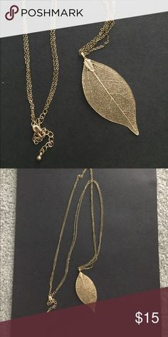 """Long Gold Leaf Filigree Necklace Gold double chain. Beautiful leaf necklace. Adjustable clasp closure. Measures 18"""" Top to bottom of leaf at the shortest link,  21.25"""" longest link. Jewelry Necklaces"""