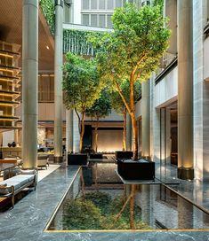 "Sheraton Shenzhen Nanshan building, China, by CCD / Cheng Chung Design (HK): architects base design on ""mountain, water and cloud"", waterscape with bamboos. Hotel Lobby Design, Luxury Hotel Design, Home Design, Design Design, Shenzhen, Atrium Design, Great Hotel, Hotel Interiors, Hotel Decor"