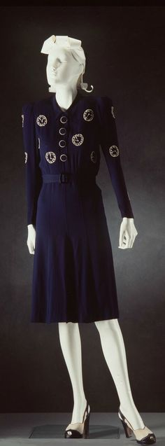 Day Dress: ca. 1935, blue crepe, embroidered clock design.