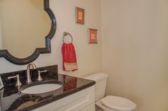 Powder Room off Kitchen and Family Room