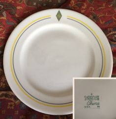 "Syracuse China 7 1/4"" side plate (2). Topmark is AN within diamond. Date code 89, fourth dot missing. (April 1960). .... Second plate date code 94-D (April 1965)."