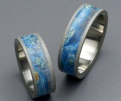 Skies above, Earth below. Blue Box Elder is deliriously gorgeous. Gentle streams of blue gather around pale yellow sunbursts. This set is a nod to the great work of Van Gogh - fine art around your finger! A sandblasted edge adds texture. Wooden Wedding Bands, Custom Wedding Rings, Titanium Wedding Rings, Titanium Rings, Royal Rings, Hanging Jars, Geek Wedding, Wedding Ideas, Wedding Stuff