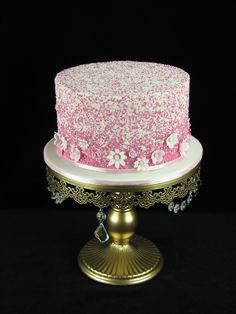 This is a recreation of one of Jenelle's Custom Cakes designs. It's so pretty and will also get a bunting added on top. Inside is chocolate cake with chocolate ganache and covered in buttercream to hold the sprinkles. — at Wallington Park Equestrian Centre.