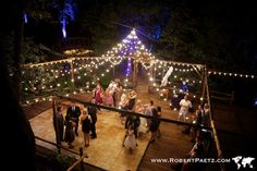 Pine Rose Cabins Wedding with a canopy of light. RobertPaetz.com