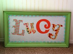 Name art for kids rooms - used scrapbooking paper and a thrift store frame!