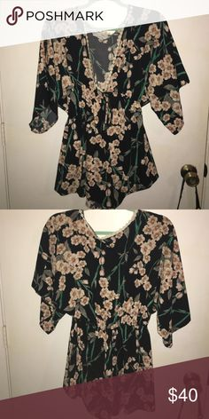 Floral Romper Such a cute romper you could dress up or down with a plunging v neck.. worn once for my birthday. audrey31 Other