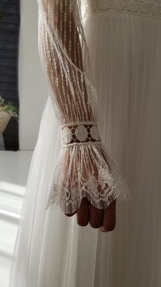 Lace detail on wedding dress with long sleeves