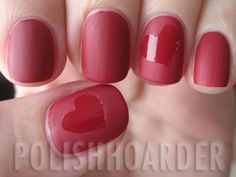 Paint you nails shiny red, place a heart shaped sticker on top, and then paint over the nails with a matte finisher.