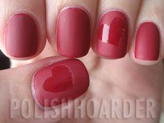 Shiny hearts on matte nails.