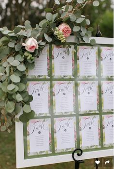 Seating assignments. The board was purchased from Michael's. We ordered green rice paper from Etsy and our Etsy stationer printed the table number sheets with guest names. Our wonderful florist - Elegant Bee - provided the flowers.