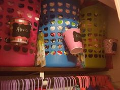 Tall baskets with the next seasons cloths. Three girls in one closet! The girls recieved little bins with their names on them so I attached them with matching colored hair bows. The bins hold the little items they have to ask me for!
