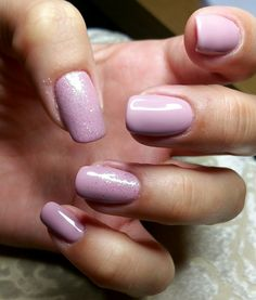 Light pink gel nails with white pinkish glitter