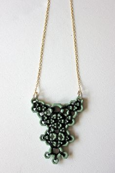 Black and Blue Hex Nut Pendant Necklace. $60.00, via Etsy.