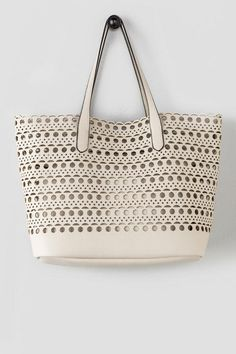 f2920fd763 Jayden Perforated Tote- This ivory bag features a perforated design as well  as an inside pouch to keep all of your things protected.