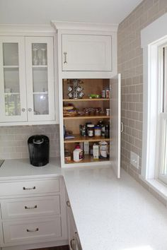 A kitchen remodel in Narragansett, Rhode Island, by Coventry Lumber, a StarMark Cabinetry dealer in Coventry, Rhode Island. They specified StarMark Cabinetry's Fairhaven inset door style in Maple finished in a cabinet color called Marshmallow Cream.