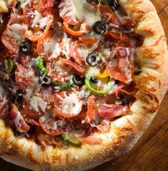 This monster starts with a cheese-stuffed crust and has Hall of Fame written all over it. Its topped with four kinds of meat, two kinds of cheese, bell peppers and black olives. pizza-stromboli-and-calzones Pasta Pizza, Meat Pizza, Pizza Food, Crust Pizza, Pizza Recipes, Cooking Recipes, Great Recipes, Favorite Recipes, Love Pizza