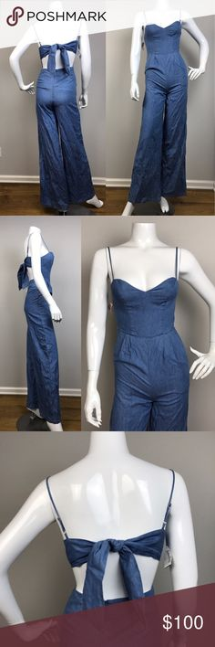 "NWT Lovers + Friends denim blue jumpsuit NWT Lovers + Friends denim blue jumpsuit. Adjustable straps. Open back with tie. 10% cotton. There is a small tear at the back, see image 4.  Waist approximately 24"". Inseam approximately 32"". Lovers + Friends Pants Jumpsuits & Rompers"