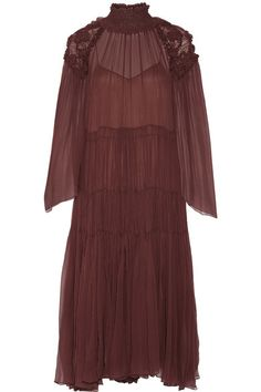 Chloé's Fall '16 runway collection references the free-spirited style of Anne-France Dautheville who traveled across Europe and the Middle East on a motorbike in the '70s. Cut from whisper-weight silk-georgette, this merlot piece has elegantly folded ruffles and smock detailing to frame the turtleneck and shoulders, before billowing out into a tiered, fluted skirt. The removable slip tempers its sheerness.