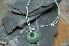 The Amala Necklace, with beautiful green aventurine gemstone pendant. Simple and elegant abundance necklace.  Necklace length is approximately 18 inches, with a small extender chain which ends with a lovely silver heart. A leaf charm at the end of the chain can be requested at checkout if you prefer not to have the heart.  This is a limited edition design, as i dont have lots of the beautifully carved pendant.  Designed and Handmade by me Molax Chopa  To view more of my collections and…