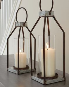 Ashley Furniture Diedrick Lantern Set of 2 with Made of galvanized metal with antiqued finish and glass hurricane shade,Indoor/outdoor safe,Pillar candles not included Black Lantern, Lantern Set, Lanterns Decor, Rustic Lanterns, Hanging Lanterns, Farmhouse Furniture, Furniture Decor, Office Furniture, At Home Store