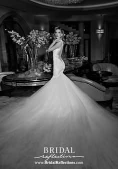 http://www.bridalreflections.com/ Loretta has a body exuding bodice, with an extravagant tulle skirt and train is detachable. The dress is a combination of blush and ivory. The bodice of the dress is made of crochet ivory lace, decorated with an embroidered antique lace. The gown is embellished with pearls and crystals. The back is low and has a sheer illusion tulle for support.
