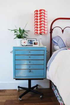 office furniture as night stand- file cabinet and chair wheels.