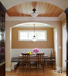 Windowed Breakfast Nook; The addition of an overhead window brightens up this cozy breakfast nook. A built-in L-shape bench pairs with a simple kitchen table and wooden dining chairs to take advantage of an awkward bump-out. Although natural light is abundant during the daytime, a low-hanging chandelier ensures family dinners and dinner parties can last well into the evening hours.