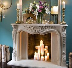 Grouped candles in a fireplace