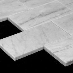 (http://www.carraratiles.com/carrara-marble-italian-white-bianco-carrera-6x12-marble-subway-tile-honed.html)
