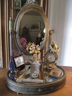 Pretty French dressing table mirror, cherub clock, perfume bottles i could come up with a wooden shabby chic style one of these!