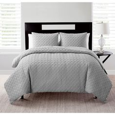Refresh the look of your bedroom with this simple and elegant comforter set. Crafted from polyester, this set features geometric textured detailing and is available in a array of calming colors. The d